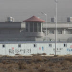 A guard tower and barbed wire fences around a facility in Artux in western China's Xinjiang region